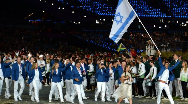 Marching Proud: The Israeli Olympic team carries the flag at the Opening Ceremonies of the London Games.