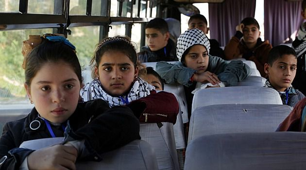 Palestinian children on a planned goodwill trip wait on a bus at the Israeli border. Their visit was scrapped after Hamas objected to the plan.