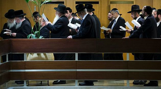 Mourning Ritual: Knesset members mourn passage of measure ending exemption for ultra-Orthodox Jews from military service.