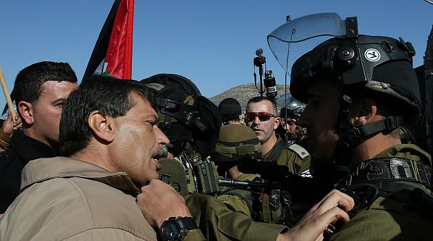 Face Off: Palestinian minister Ziad Abu Ein scuffles with Israeli troops during a protest on the West Bank. He later died.