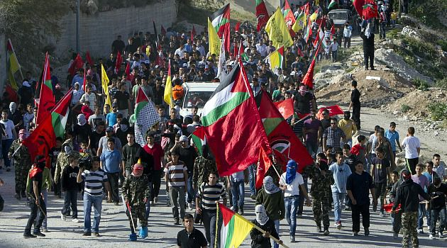 Anger in Street: Palestinian students protest the death of a prisoner in Israeli captivity.