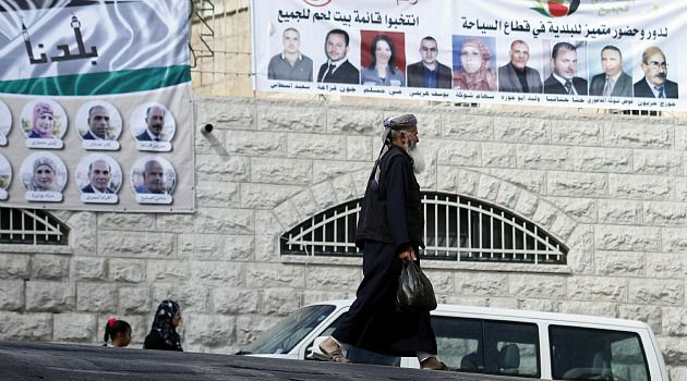 Election Fever: West Bank towns are plastered with posters as Palestinians prepare to vote in local elections.