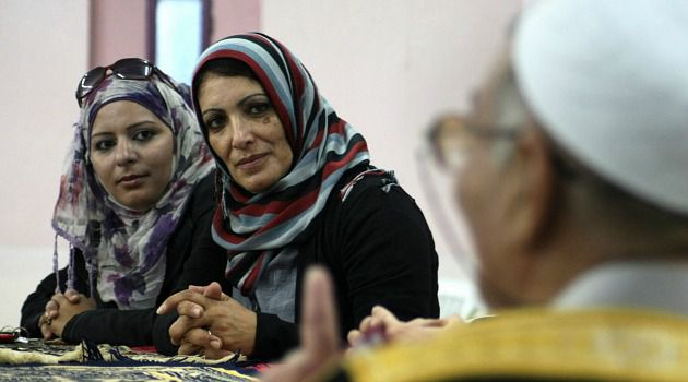 Changing Society : Palestinian women are pressing for a bigger role in a society still dominated by men. Part of that struggle includes running for political offices.