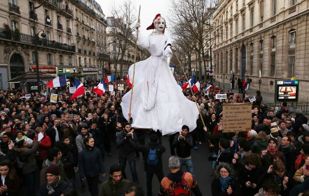 Unity: Demonstrators participate in a mass rally following the recent terrorist attacks in Paris, where an estimated one million people have converged.
