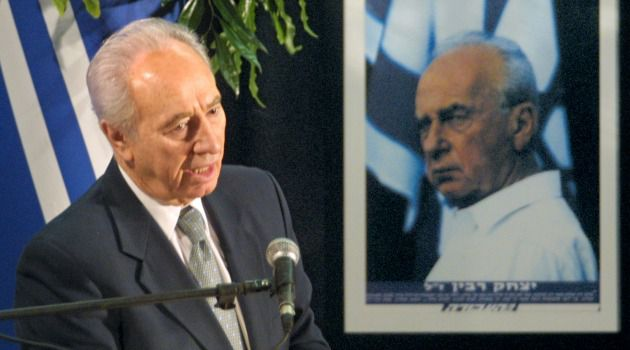 Two Leaders: Former Israeli president Shimon Peres speaks in front of a poster of assassinated Prime Minister Yitzhak Rabin.