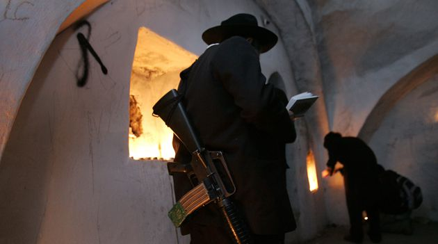 No Two States: Ultra-Orthodox Jews pray by candlelight in the West Bank.