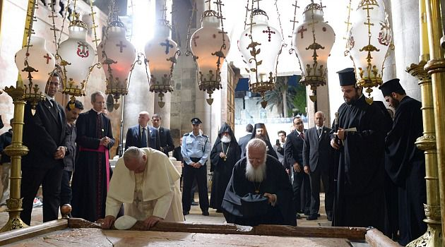 Pope Francis prays at the Church of the Holy Sepulchre in Jerusalem.