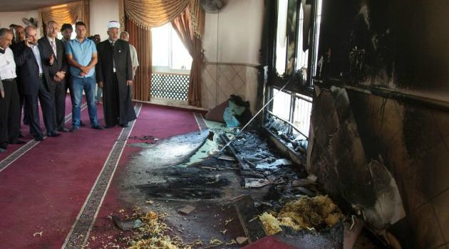 Some Price: Palestinians inspect damage to mosque after attack carried out by extremist Jewish settlers in the occupied West Bank.