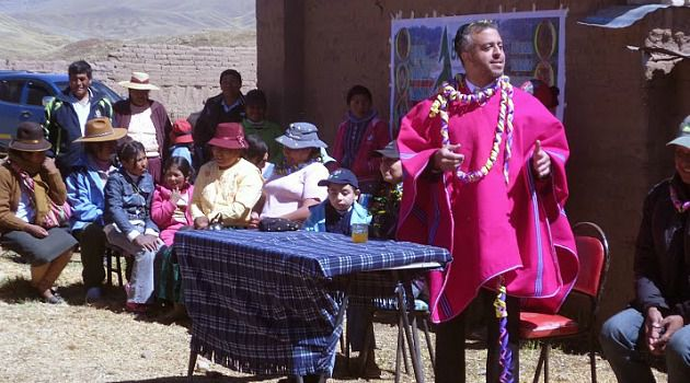 Unlikely Champion: Rabbi Shoshan Ghoori stands surrounded by Andean villagers and children.