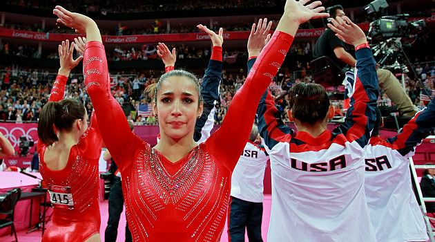 Gold! Alexandra Raisman celebrates the U.S. women?s team?s victory in the Olympics. She goes for individual gold on Thursday.
