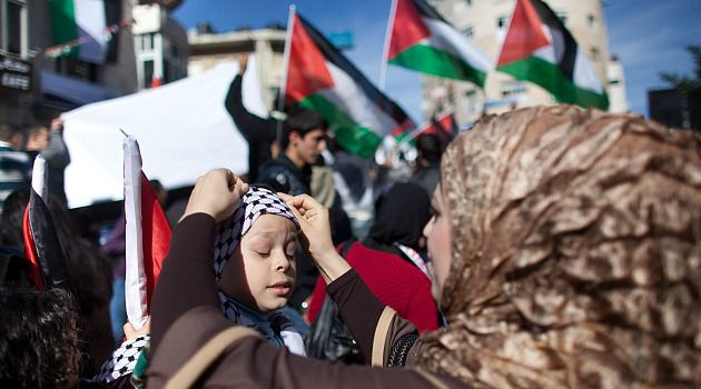 Ramallah Rally: Palestinians cheer the expected approval of the push for statehood at the United Nations.