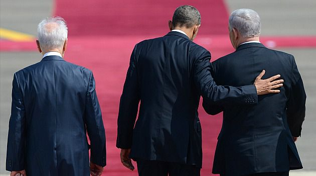 Red Line on Tarmac: Barack Obama walks with Benjamin Netanyahu and Shimon Peres at the airport in Tel Aviv. Despite the leaders? well-publicized differences, they managed to share a few yucks over the ?red line? on the tarmac.