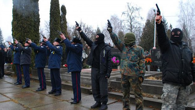 Far right wing gunmen and Ukrainian policemen at the funeral of Alexander Scherbanyuk.