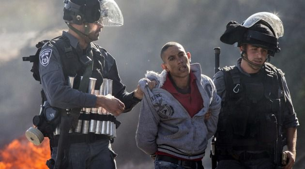 Aftermath: Israeli security forces detain an Arab-Israeli youth during clashes in the town of Kfar Kana, in northern Israel, a day after security forces shot dead a 22-year-old Arab-Israeli.