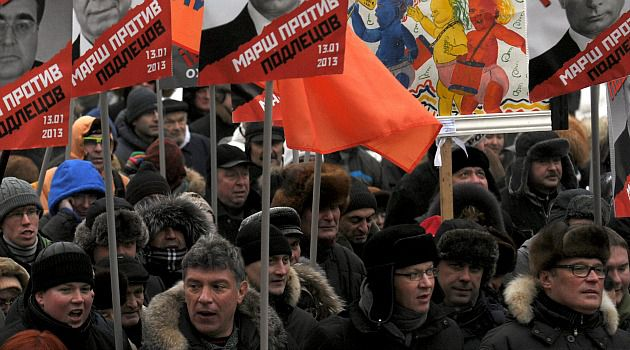 Bundled Up: A massive crowd gathered in Moscow to denounce Vladimir Putin?s ban on American adoptions of Russian orphans.