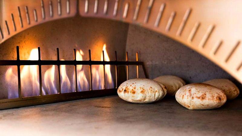 Pita baking in the oven at Sababa.
