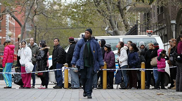 No Easy Path: Long lines and stubborn power cuts are making life difficult for New Yorkers struggling to recover from Sandy.