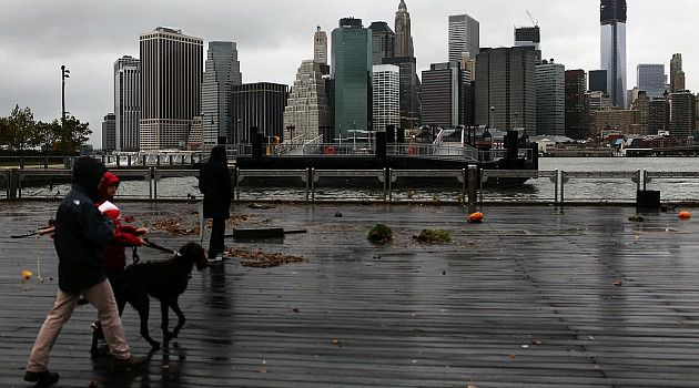Battered: The record surge from Sandy swamped lower Manhattan as the massive storm wreaked havoc up and down the East Coast.