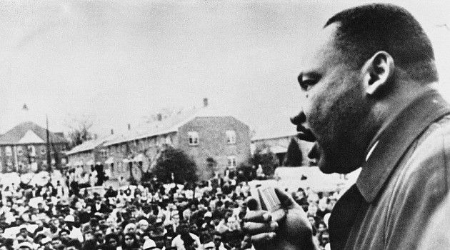 Partners: Dr. Martin Luther King Jr. addresses rally in Selma, Alabama after famed 1965 civil rights march.