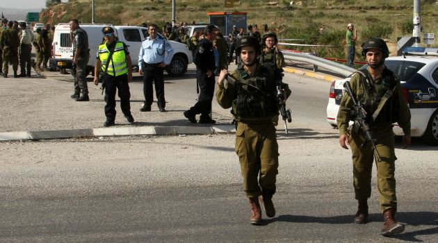 Killing: Israeli military investigate murder of Jewish settler at a West Bank bus stop.