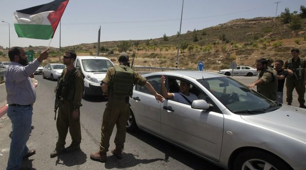 Rising Tension: Jewish settler and Palestinian man face off in West Bank highway. Tensions are increasing in the occupied territory.
