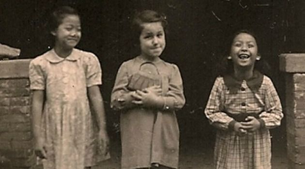 New Home: A Jewish refugee child plays with Chinese friends in Shanghai, where thousands escaped from Nazi Germany.