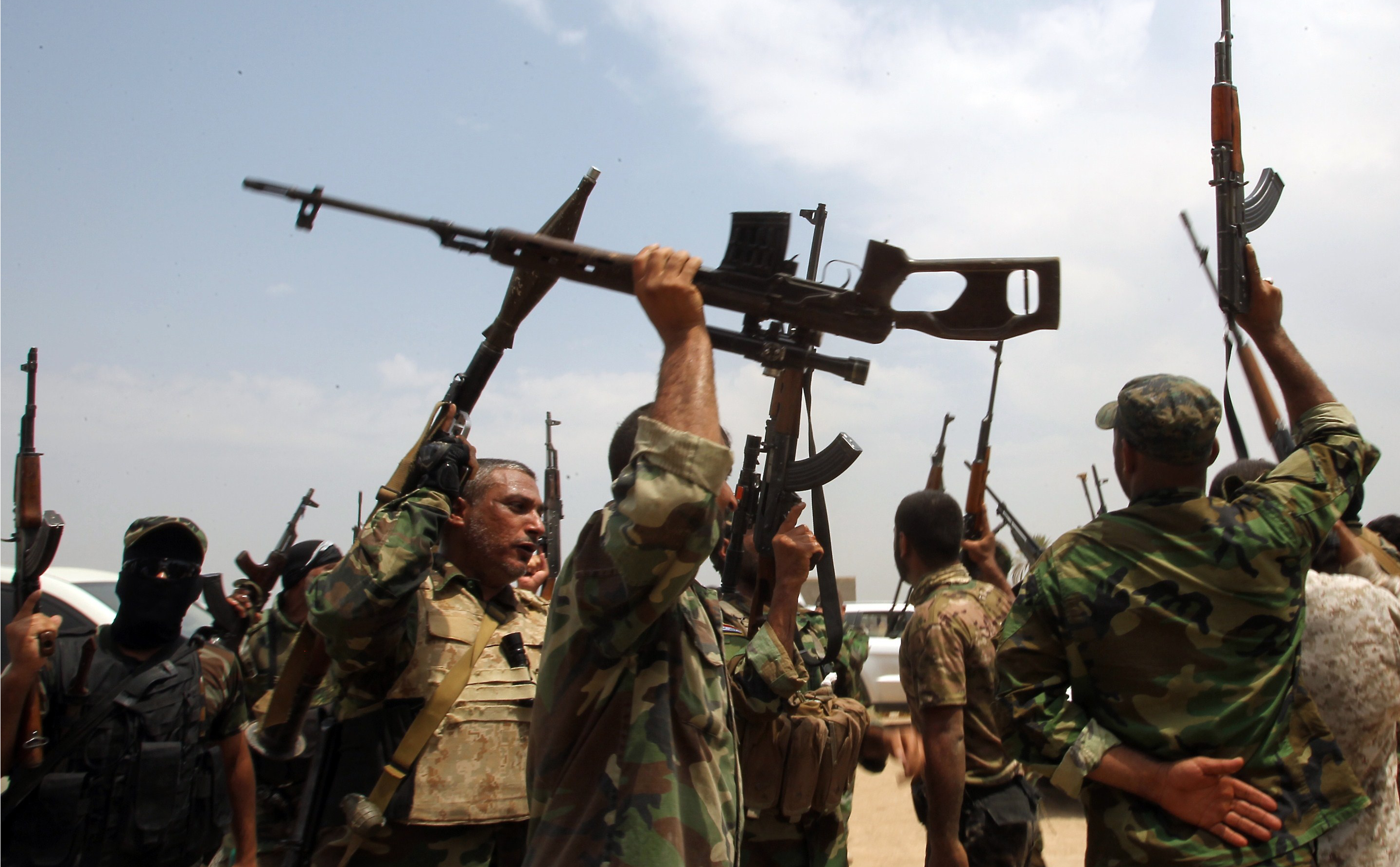 On the march:Anti-ISIS Shiite fighters in Iraq.