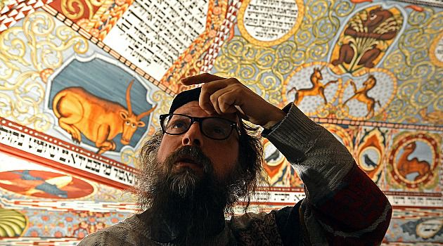 Intricate Recreation: Boaz Pash, chief rabbi of Krakow, explains the symbols on the reconstructed roof of a 18th century wooden synagogue that once stood in the town of Gwozdziec. The meticulous model is a centerpiece of the new Jewish museum in Warsaw.