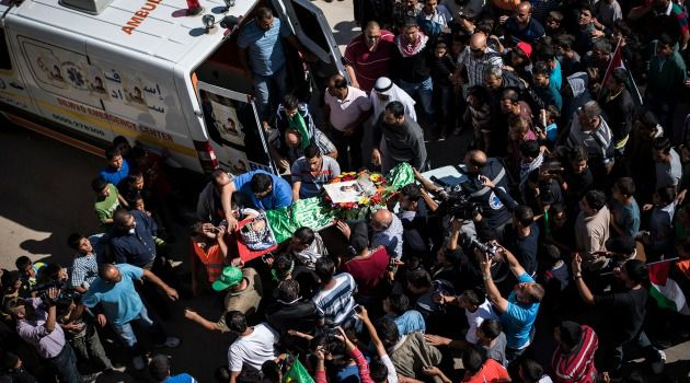 Fresh Grief: The body of Palestinian-American Orwa Hammad is carried during a funeral on October 26, 2014 in Silwad, West Bank.