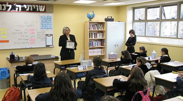 Reading Tea Leaves: Assemblywoman Helene Weinstein reads to students at a Brooklyn yeshiva. In a nod to growing Orthodox political power, the lawmaker introduced a bill that will expand state funding of special education students at Jewish schools.