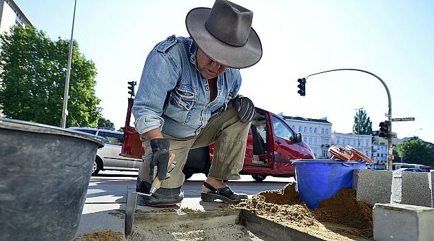 Out of ?Step?: German artist Gunter Demnig works on his ?Stumbling Blocks? Holocaust memorial. Vandals damaged the installation on the anniversary of the Kristallnacht pogrom.