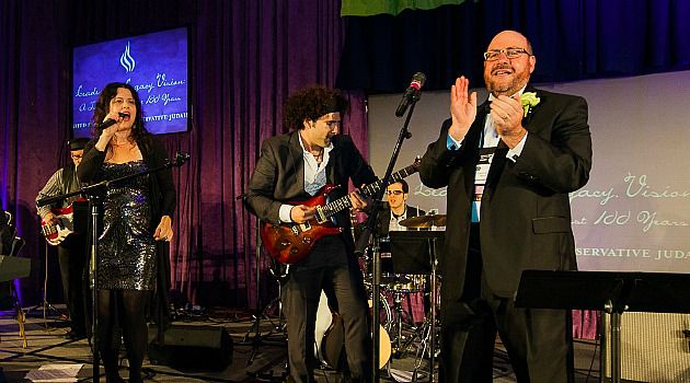 Rockin? Rabbi: Steve Wernick, right, celebrates at the Conservative movement?s centennial convention.