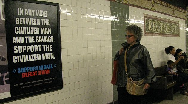 Passing Glance: A subway rider walks past controversial ad suggesting opponents of Israel are ?savage.?