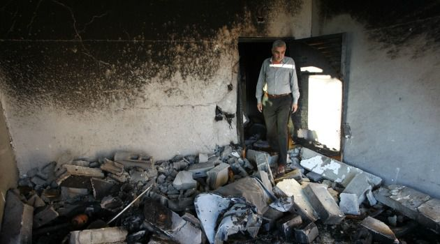 Surveying the Damage: A relative inspects the house of Amer Abu Eishe, a Palestinian named by Israel as one of the two prime suspects in the murder of three kidnapped teenagers, after the house was blown up by Israeli army.