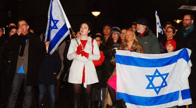 Annika Hernroth-Rothstein (in white coat) at a pro-Israel demonstration on Nov. 22, 2012 in Stockholm.