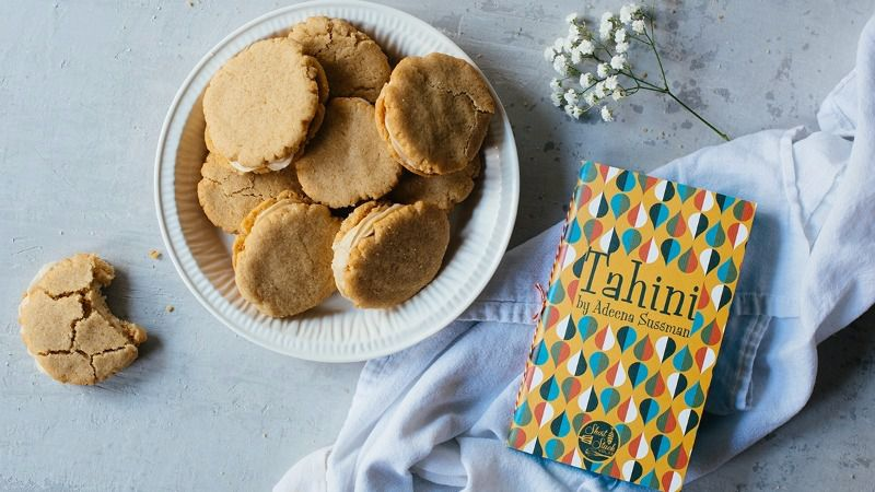 Team Tahini: Light, crumbly cookies with tahini-cream cheese frosting are among the recipes in a new cookbook by Adeena Sussman.