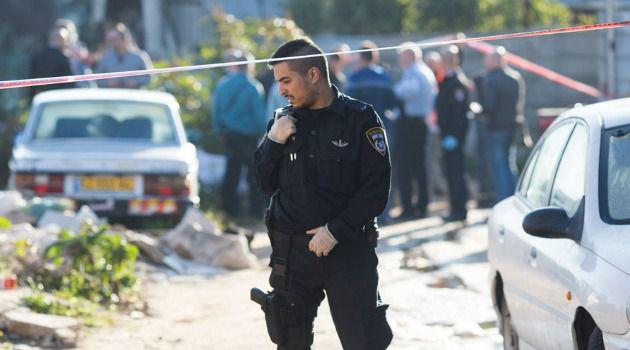 Israeli policeman guards scene of a bus stabbing in Tel Aviv.