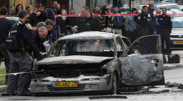 Mafia Strikes: Israeli police investigate wreckage of car that was detonated in downtown Tel Aviv. They suspect a mob hit, not terror, was the motive.