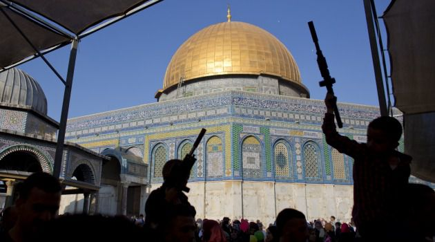 Holy Site Fight: Palestinians hold up plastic guns during demonstrations on Jerusalem's Temple Mount.