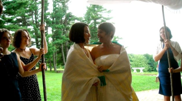Happy Couple: Idit Klein, right, the executive director of Keshet, married Jordan Namerow under a chuppah at their 2011 wedding in Massachusetts, which was officiated by two rabbis.