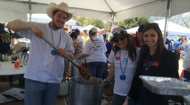 Hot Moishe! The winner of the People?s Choice award at the 2014 Dallas Kosher Chili Cookoff was Moishe House, represented by Austin Litoff (with big stirrer), an alumnus, with residents Jaycee Greenblatt (center) and Elissa Riesenfeld (right).