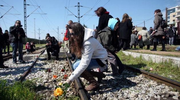 Always Remember : Participants in a ceremony marking the 70th anniversary of the deportation of Jews from Greece toss flowers on the railroad tracks in the city of Thessaloniki.