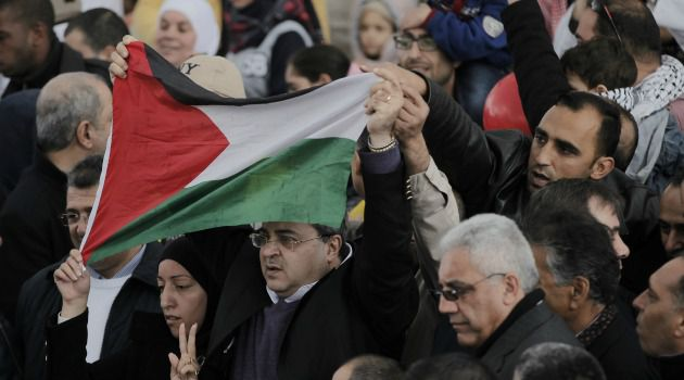 Birthday Party: Ahmed Tibi, Israeli-Arab member of the Knesset, waves a Palestinian flag during a ceremony commemorating the birth of Prophet Mohammed.