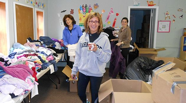 Small Shul, Big Impact: Volunteers at Congregation B?nai Israel help pack clothing for distribution to families who lost everything in Sandy.