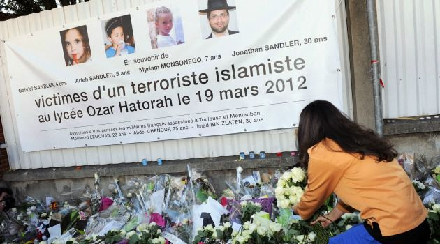 A makeshift memorial outside Ozar Hatorah school after the 2012 rampage at the school in Toulouse, France.