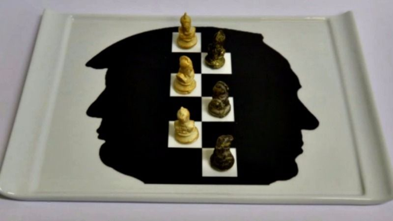 Meeting of minds? For dessert the two leaders could gaze at their own profiles, which were fused as the backdrop for pralines shaped like chess pieces.