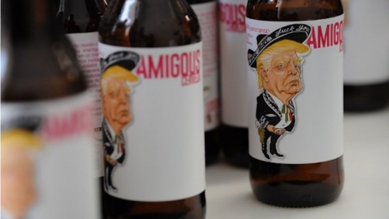 On the label of Amigous Cerveza, President Trump is sporting a swastika belt buckle.
