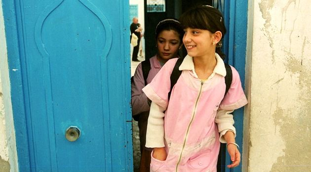 Young, Jewish, Tunisian: Two Jewish girls leave school after they attended classes at the synagogue in Djerba, south Western Tunisia.