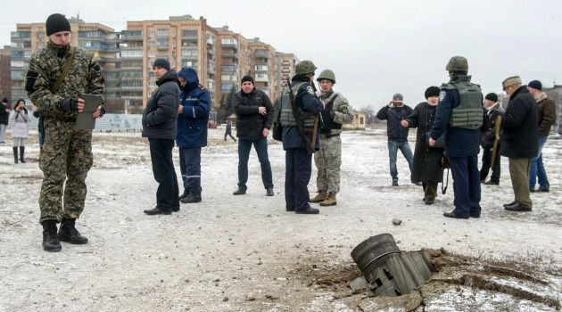 People gather around an unexploded missile in the east Ukraine town of Kramatorsk.