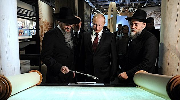 Warm Guy: Vladimir Putin, shown touring a Jewish library in Moscow, has displayed much warmth to the Jewish community. Is it for real, or show?
